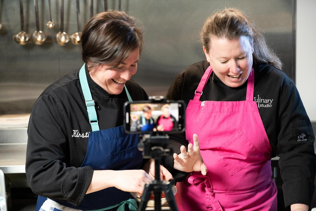 Two women chefs filming a demonstration